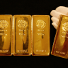 Chaotische handel in goud wijst op verbetering van het sentiment